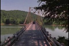 Minivan travels bridge Stock Footage