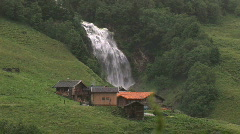 Mountain cabin with big waterfall - stock footage
