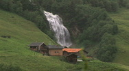 Stock Video Footage of Mountain cabin with big waterfall