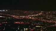 Stock Video Footage of Honolulu Hawaii at night from above pan rt HD
