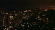Stock Video Footage of Honolulu Hawaii at night from above pan lft HD