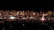 Stock Video Footage of Honolulu Hawaii at night from above bright wide HD