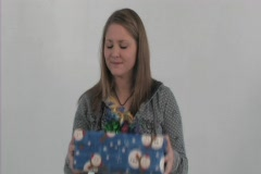 Girl opens bad present 2 Stock Footage