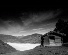 Loneliness alpin cottage above the clouds - stock footage