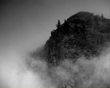 Mystic rock in the mountains with fog - stock footage