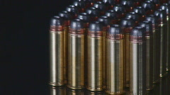 Silver bullet highlighted among other ammunition Stock Footage