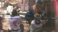 Paintball guys hit in helmet HD Stock Footage