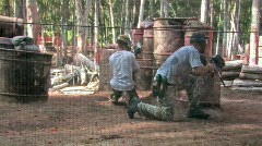 Paintball two guys through fence HD Stock Footage