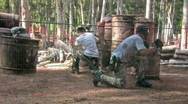 Stock Video Footage of Paintball two guys through fence HD