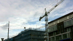 Time-lapse: Blue sky moving over building construction Stock Footage