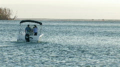 Small fishing boat heading out to sea Stock Footage