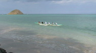 Stock Video Footage of Canoe outrigger off beach HD