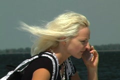 Beautiful Blonde with Cell Phone Outdoors Stock Footage