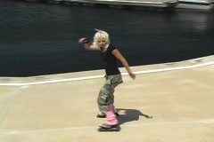 Beautiful Blonde Rollerblader Takes a Spill Stock Footage
