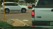 Cars moving through intersection Stock Footage