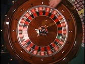 Stock Video Footage of Overhead roulette wheel ball thrown in