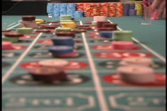 Rack focus placing roulette bets - stock footage