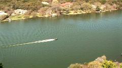 Speed boat traveling along Lake Travis Austin TX - stock footage