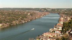 Power boat speeding along calm waters of Lake Travis Stock Footage