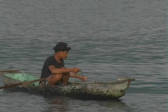 Man on small fishing boat in lake. Stock Footage