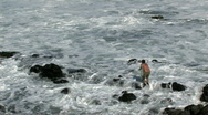 Maui rocky shore man fish net HD Stock Footage