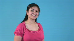 Motioning come with me a lovely Hispanic girl Stock Footage