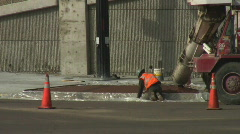 Concrete delivered down chute to workers - stock footage