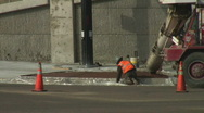 Concrete delivered down chute to workers Stock Footage