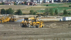 Heavy construction equipment excavates soil preparing for site construction Stock Footage
