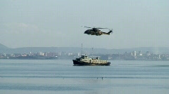 Military helicopter over a ship Stock Footage