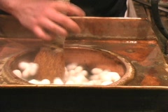 Silkworm floating in hot water Stock Footage