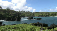 Maui Hana Black sand beach over green HD Stock Footage