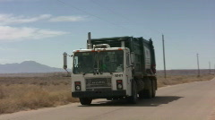 Editorial: Trash Truck tracking shot Stock Footage