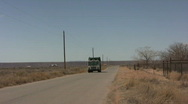 Stock Video Footage of Editorial: Trash Truck tracking shot
