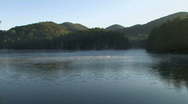 Stock Video Footage of Morning Mist on Mountain Lake - wide