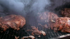 Smoking roasts on barbeque wagon - stock footage