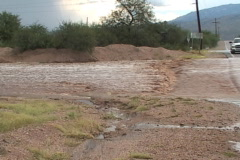 Flooded street and desert after a monsoon storm Stock Footage