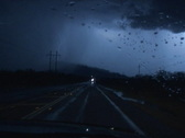 Driving at night with strong lightning - slow motion Stock Footage