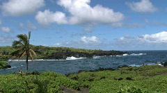 Maui Hana black volcanic cliff surf Hawaii HD Stock Footage