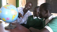 Disabled girls get a geography lesson from a teacher in their school in Kenya Stock Footage