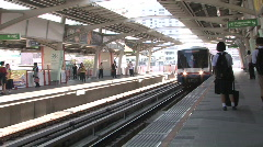 Metro train arrives at a station in Bangkok Stock Footage
