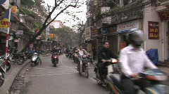 Motor scooters on the streets of Hanoi, Vietnam  Stock Footage