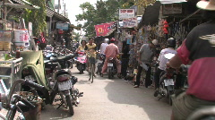 Narrow market street in a typical town in Vietnam Stock Footage