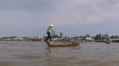Woman rows her water taxi service boat in Vietnam Stock Footage