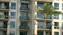 Hawaiian resort close balconies pan left M HD Stock Footage