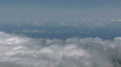 Looking down on clouds pan left M HD Stock Footage