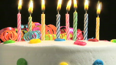 Birthday candles on cake, time lapse - stock footage