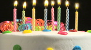 Birthday candles on cake, time lapse Stock Footage