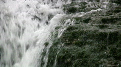 Waterfall on eroded limstone rock Stock Footage