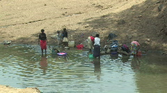 Women wash clothes in river in Kenya, Africa Stock Footage